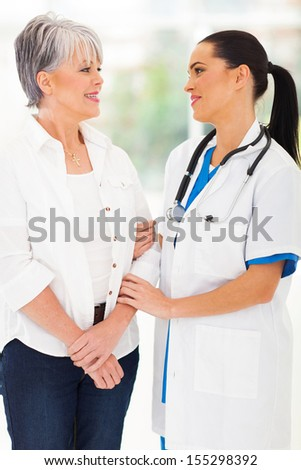 friendly female medical doctor talking ot middle aged patient