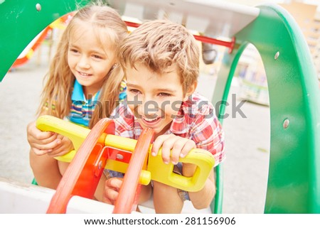 Friendly girl and boy spending leisure on playground - stock photo