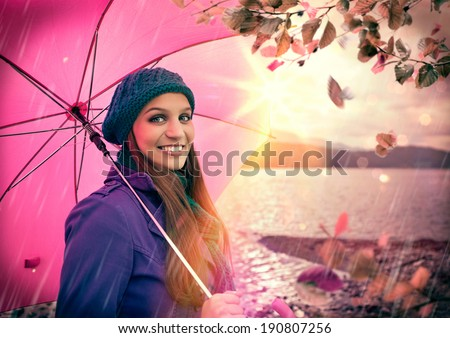 friendly girl laughing with pink umbrella - stock photo