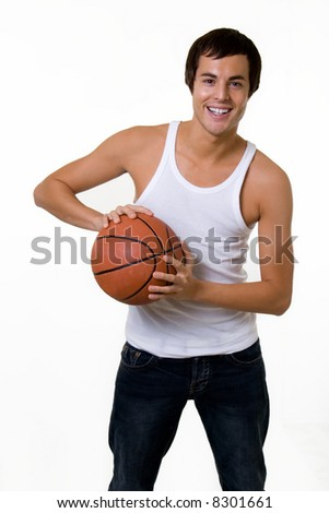 Friendly handsome young brunette man in white undershirt tank top holding a basketball