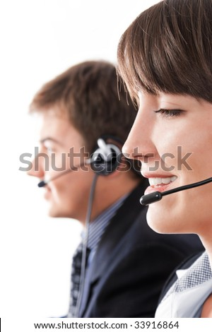 Friendly help-desk operators over a white background - stock photo