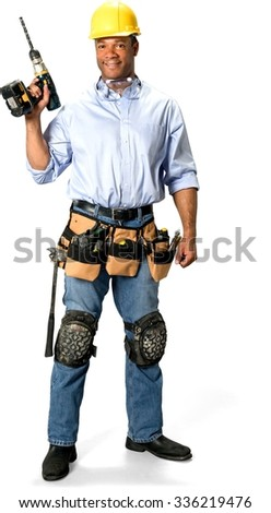 Friendly Male Construction Worker with short black hair in uniform holding drill - Isolated - stock photo