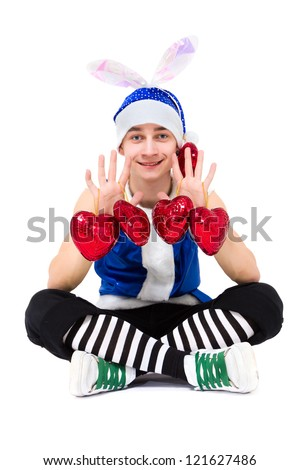 friendly man dressed like a funny gnome with red hearts posing on an isolated white background - stock photo