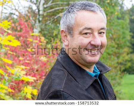 Friendly men portrait in autumn - stock photo