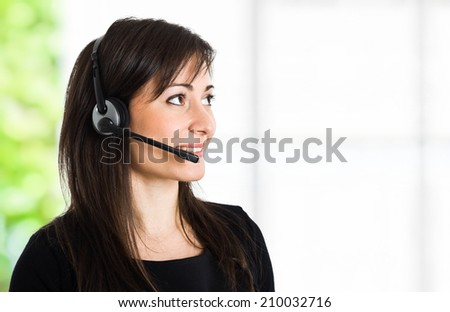 Friendly phone operator helping a customer