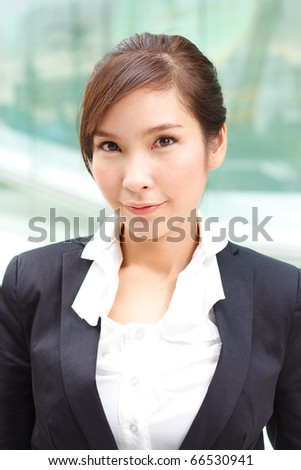 Friendly portrait of confident business woman