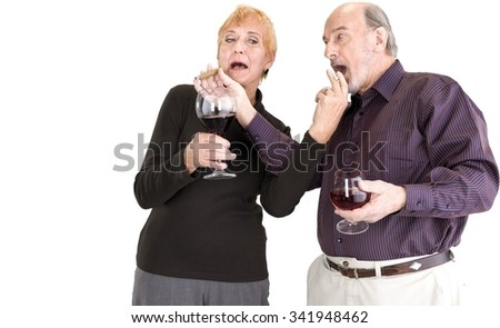 Friendly Senior Male & Female Couple in casual outfit holding cigarette - Isolated