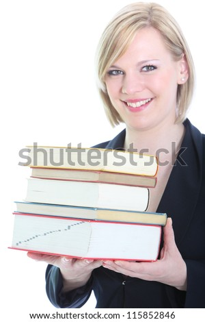 Friendly smiling blonde holding bunch of books isolated on white - stock photo