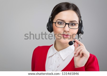 Friendly smiling customer support woman - stock photo