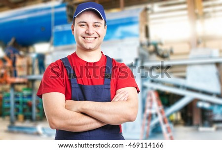 Friendly smiling mechanic