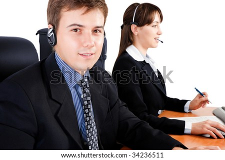 Friendly telephone operators in an office environment - stock photo