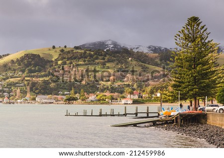 Friendly town of Akaroa, New Zealand - stock photo