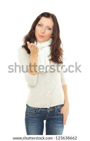 Friendly woman sends a kiss - stock photo