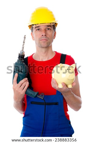friendly worker with helmet, drill and piggy bank - stock photo