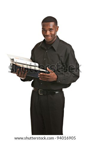 Friendly young black businessman holding binders on isolated white background - stock photo