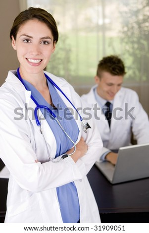 Friendly young medical professionals working in an office