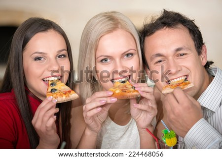 Friends are eating pizza. Close-up. - stock photo