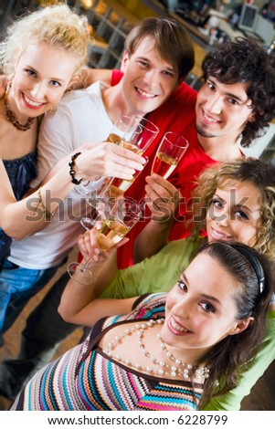Friends at a celebration enjoying a champagne - stock photo