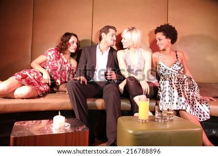 Friends at a nightclub - stock photo
