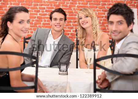 friends at table - stock photo