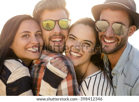 Friends at the beach enjoying the summer - stock photo