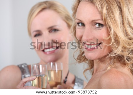Friends celebrating with a glass of wine