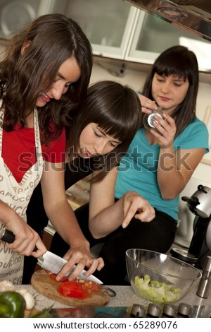 friends cooking together - stock photo