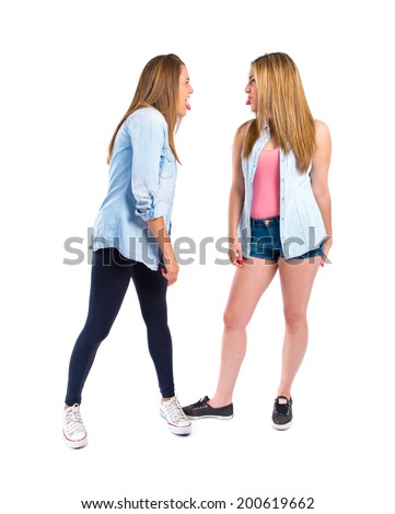 Friends doing a joke over isolated white background