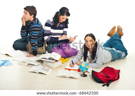 Friends doing their homework together and sitting on floor