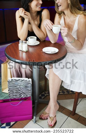 Friends Drinking Coffee and Shopping - stock photo