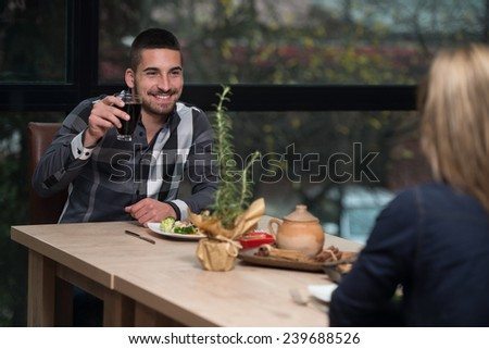 Friends Eating At A Restaurant And Looking Happy - stock photo