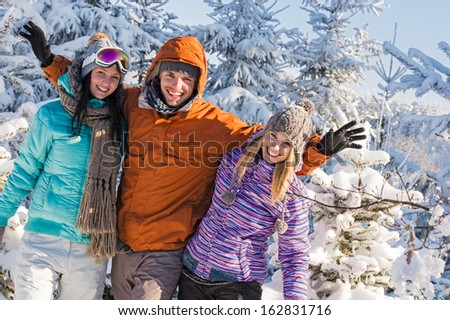 Friends enjoy winter holiday break snow mountains sunny sport - stock photo