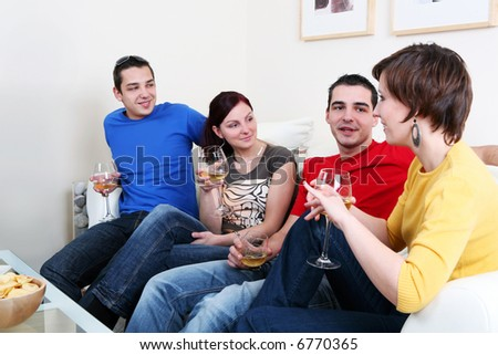 Friends enjoying a celebratory drink of wine