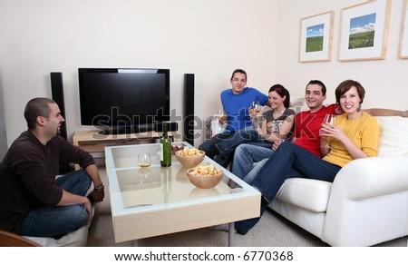 Friends enjoying a celebratory drink of wine - stock photo