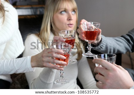 Friends enjoying a few drinks together - stock photo