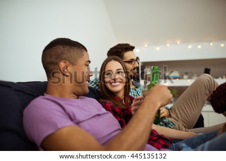 Friends enjoying beer at home party. - stock photo