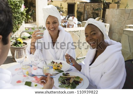 Friends enjoying meal at resort - stock photo