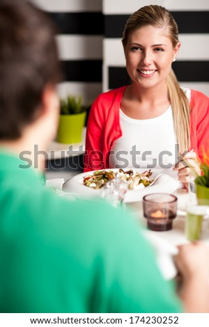 Friends enjoying meal in a restaurant - stock photo