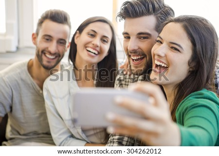 Friends faving fun and making a selfie - stock photo