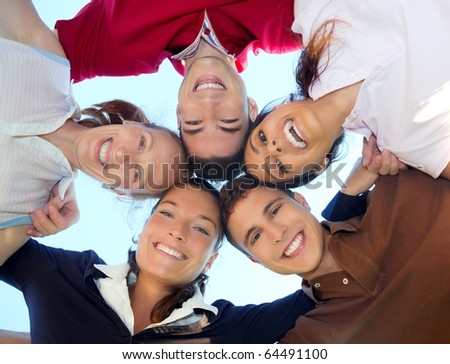 friends happy group in circle heads smiling together from below view