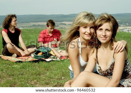 friends having a picnic - stock photo