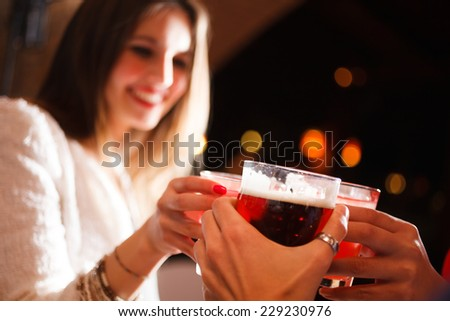 Friends having a round of drinks in a night club - stock photo