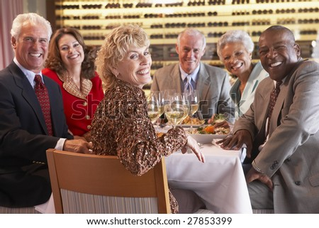 Friends Having Dinner Together At A Restaurant