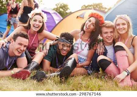 Friends having fun on the campsite at a music festival - stock photo