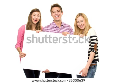 Friends holding blank poster - stock photo