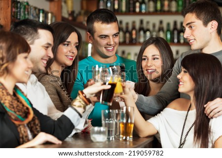 Friends in a bar - stock photo