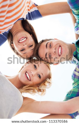 Friends in a huddle - stock photo