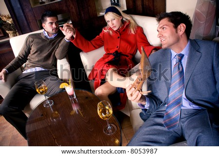 friends in cafe, focus on man in foreground and blond woman - stock photo
