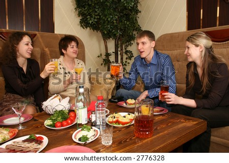 friends in restaurant - stock photo