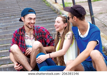 Friends joke jokes. Friends have fun together outdoors. Young people hugging - stock photo